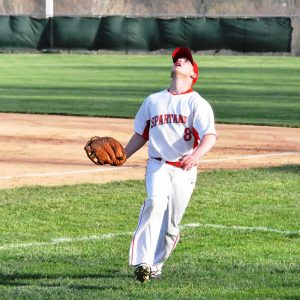1st baseman  prepares to catch a foul ball