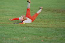 # 7 right filder . dives after a ball
