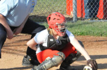 Catcher traps a ball